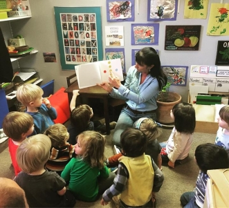 Director Jerri Thompson reads to a class of children.