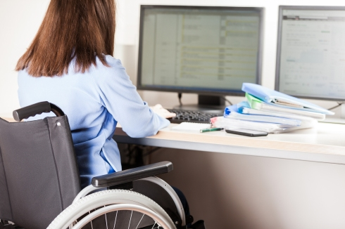 Invalid or disabled young business woman person sitting wheelcha