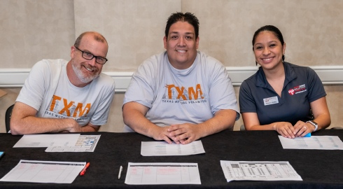 Volunteers from Texas Mutual and Workforce Solutions